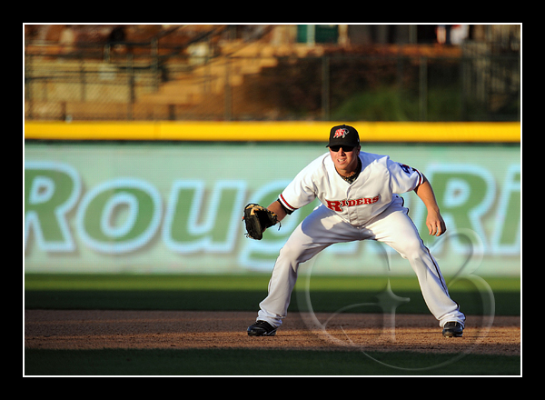 Frisco first baseman Justin Smoak #12 fights the sunlight as it sets in the West.
