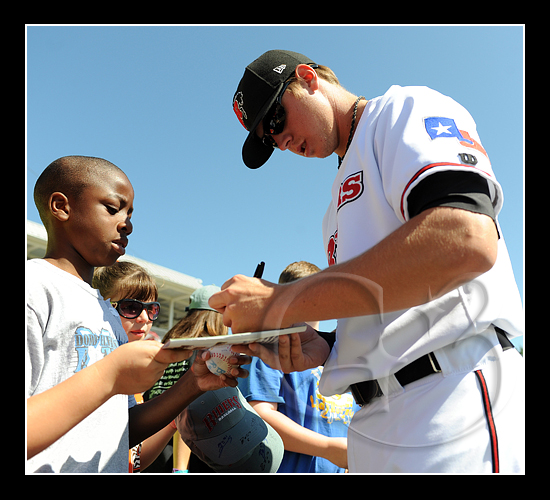 Slugger Justin Smoak #12 signs for the fans