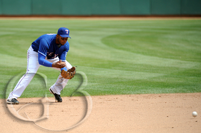 Shortstop Elvis Andrus fields a grounder for a play to first