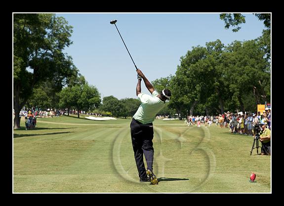 Vijay tees off at the 11th hole