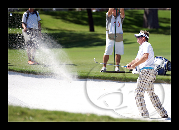 Brian Gay blasts out of a bunker at 14