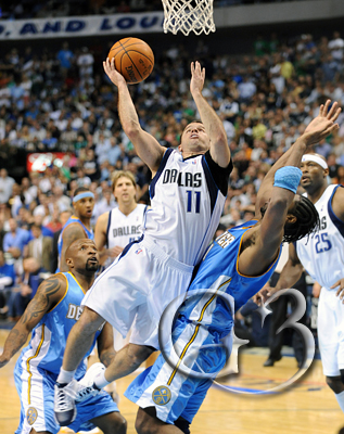 JJ Barea gets by the Denver defense for a layup