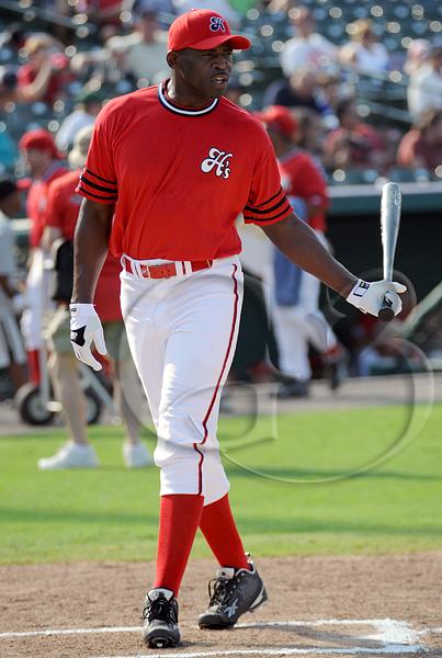 Former Dallas Cowboy Hall of Famer Michael Irvin goes up to bat