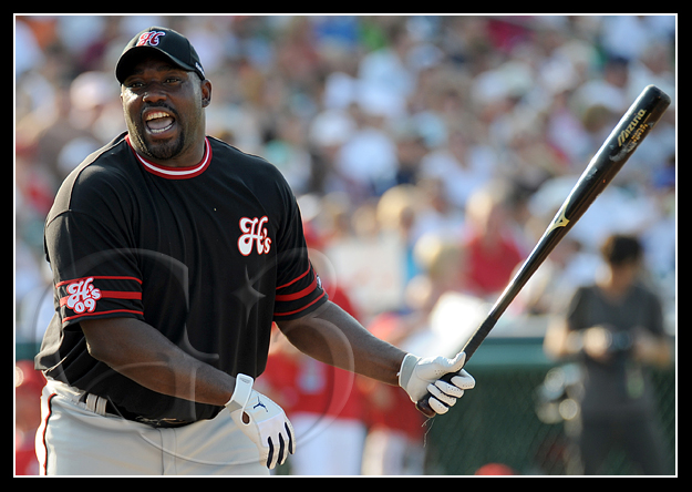 Warren Sapp of the Black Sox clowns around while at bat
