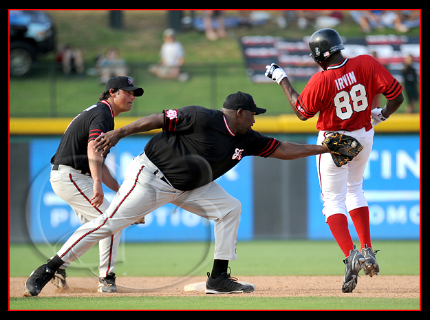 Former Oakland Raider Warren Sapp of the Black Sox makes a tag on former Dallas Cowboy Micheal Irvin goes into second base