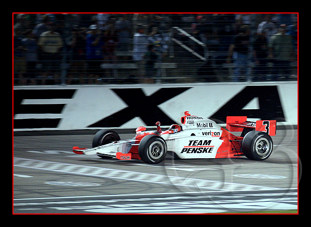Helio raises his fist in victory as he crosses the finish line to win his third race at the Texas Motor Speedway