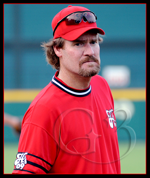 Former Boston Red Sox Hall of Famer Wade Boggs coaches at third base for the team Red Sox