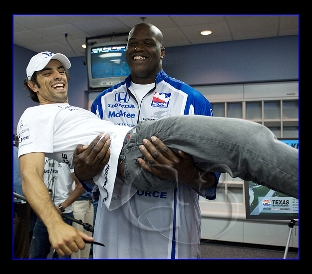 Shaq clowns around with driver Raphael Matos after his press conference