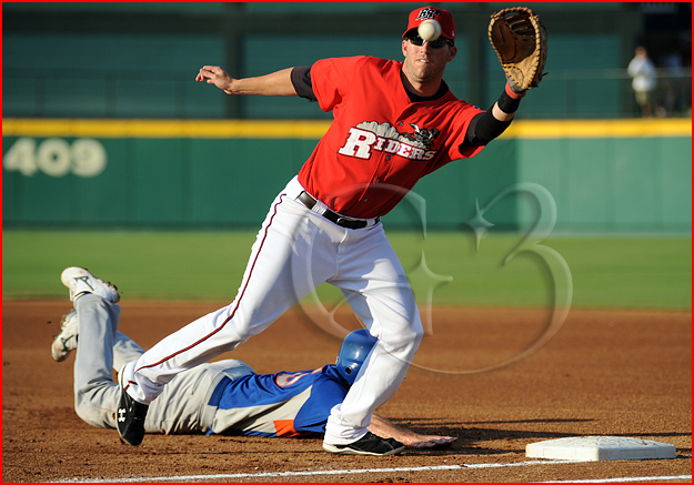Frisco Roughriders first baseman Chad Tracy #28 tries to catch a pick off throw as Midland Rockhounds baserunner Josh Horton #15 dives back