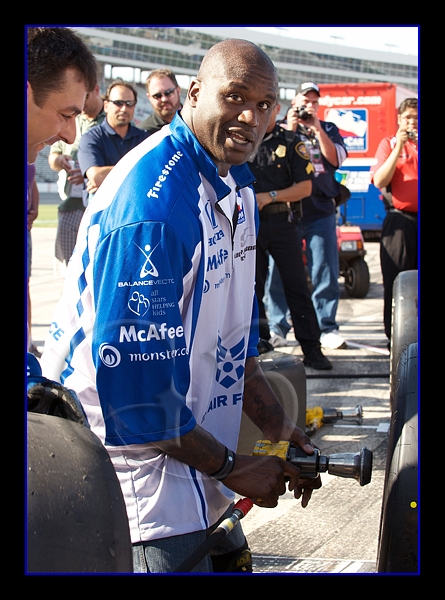Shaq changes a tire to Rapheal's car, here he was having trouble just getting the tire back on.