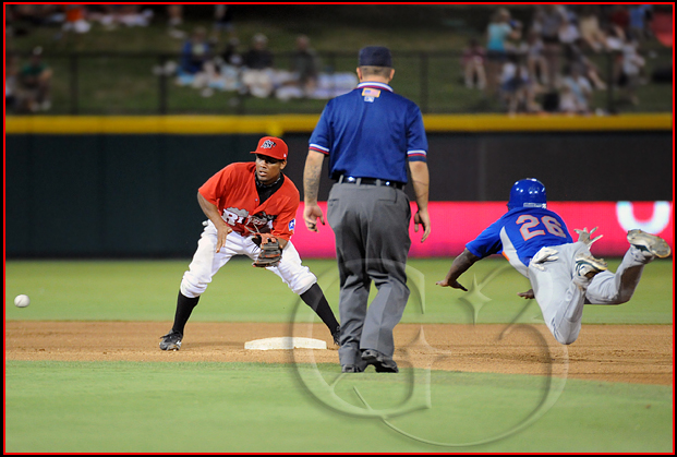 Midland Rockhounds base runner Archie Gilbert dives in safely into second base as Frisco Roughriders second baseman Marcus Lemon #1 awaits the throw from the catcher