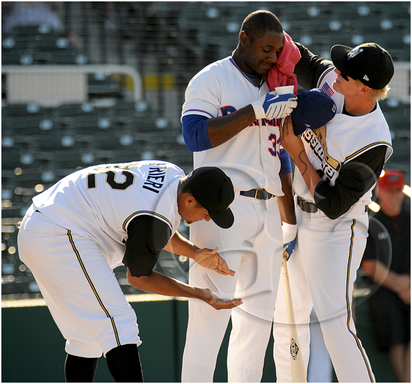 Midland Rockhounds first baseman Chris Carter #33 is cooled off and given water by his teammates after hitting 10 home runs in the first round of the home run derby