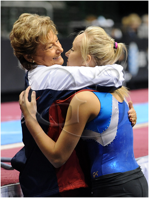 Marta Karolyi and Nastia Liukin share a hug after a long discussion before competition begins.