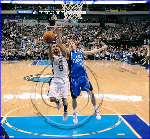 Tony Parker #9 is fouled by Dallas Mavericks power forward Dirk Nowitzki #41