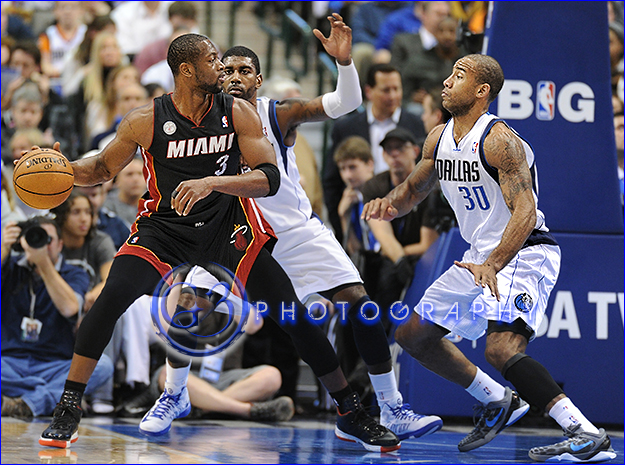 Dec 20, 2012:  Miami Heat shooting guard Dwyane Wade #3 is double covered by Dallas Mavericks shooting guard O.J. Mayo #32 and Dallas Mavericks shooting guard Dahntay Jones #30 during an NBA game between the Miami Heat and the Dallas Mavericks at the American Airlines Center in Dallas, TX  Miami defeated Dallas 110-95